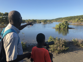 EAG Birding Expert Junior Prosper teaches son how to use the Spotting Scope to view wetland birds